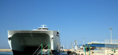 Stage of docking at the port of the catamaran